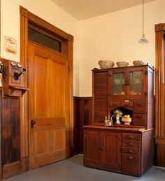 Late-Victorian Kitchen - A very early Hoosier cabinet (dating to the 1890s) provides a remarkable amount of storage space without making the kitchen look modern.