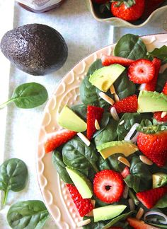 Strawberry Avocado Salad with a Strawberry Balsamic dressing -   4 cps baby spinach - 1 pint strawberries sliced - 1 avacado sliced - slivered almonds - 1 shallot sliced - STRAWBERRY DRESSING - 1/4 cp balsamic vinegar - 1/3 cp olive oil -   2 tbsps. strawberry jam