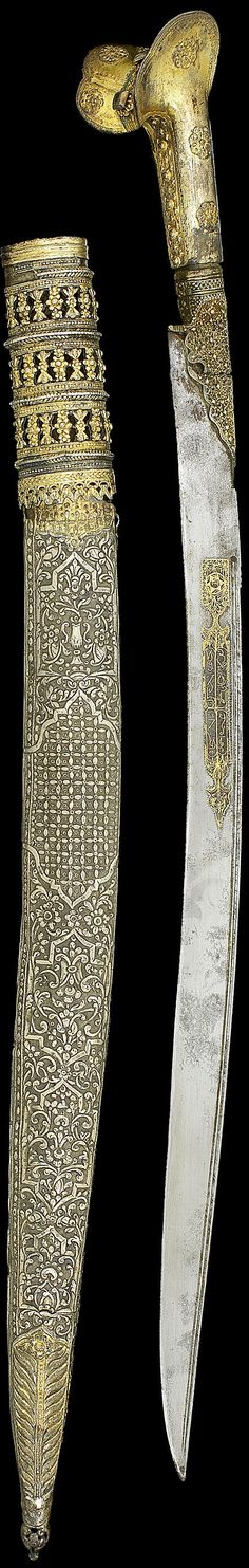 "Ottoman yatagan, 19th c, gold inlaid blade, silver-gilt grip and scabbard with filigree rosettes to sides and pommel, repousse silver scabbard with cartouches on a floral ground, gilded terminal and upper, 74.5cm. Inscribed:owner ""Asıl(?) Agha"", the dog of the Seven Sleepers ""Qitmir""; other side ""bıcak elde gerek / delde sübhan tawakkuli 'ala khaliqi / ghayrat [?] ahmad"", ""In the hand one must have a dagger, and 'Praise Him!' in one's heart, my dependance is on my creator Ghayrat [?] Ahmad""."