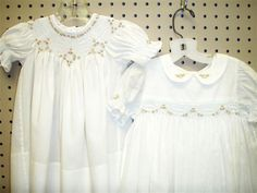 I think the dress on the left is an Australian Smocking and Embroidery magazine pattern.