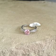 JewelScent Ring Appraised at $31. Size 6. Beautiful pink cubic zirconia stone. Really pretty ring. Make an offer! JewelScent Jewelry Rings