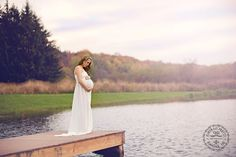 Maternity Poses in Gown on dock by Lake, Pond, Ocean   WNY Maternity Photography   www.portraitpretty.com