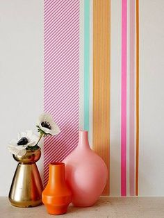 Washi tape wall decoration and spray painted vases.