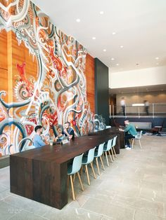 SKB Architects Creates Lively Lobby for Key Center Office Tower. Chairs by Jasper Morrison line custom tables in stained oak