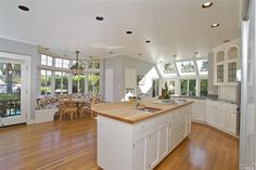 Lovely open kitchen with bay window seating. Open Kitchen, Kitchen Dining, Bay Window, Great Rooms, Cool Kitchens, Kitchen Remodel, Beautiful Homes, Hardwood Floors, Living Spaces