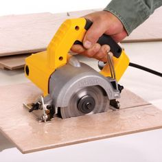 DeWalt Electric Saws, Powerful motor delivers the cutting power to cut through granite,porcelain, concrete and other stone materials. Cheap Power Tools, Cool Tools, Diy Tools, Hand Tools, Dewalt Tough System, Tool Website, Electric Saw, Tile Cutter, Carpenter Tools