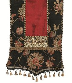 Black and red floral chenille shaped hem table runner with tassel fringe
