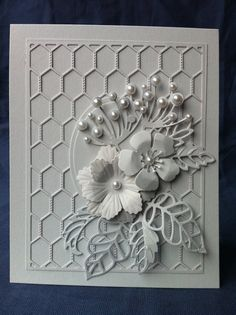handmade card ... white on white ... die cut flowers with pearls ... chicken wirre grill background ... skeleton leaves ... gorgeous ...