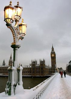 Snow covered London. I love that those people are walking in the middle of a usually very busy bridge!