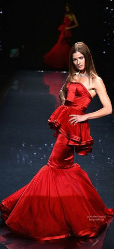 Jill Hennessy walks the runway wearing DENNIS BLASSO for the 2014 Red Dress Collection annual charity event benefiting The Heart Truth®