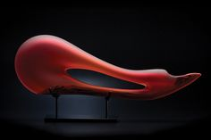 The recombinant placement of The Avelino glass sculpture by Bernard Katz expresses movement with its sweeping curves.
