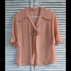 Temporary Sale!! - Coral Tie Blouse Such a lovely blouse!!  I love it, but just don't seem to wear it anymore.  No tears or stains.  Great condition. Tops Blouses