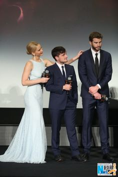 """Actress Jennifer Lawrence, with actors Josh Hutcherson and Liam Hemsworth, poses on the red carpet at the Chinese premiere of """"The Hunger Games: Mockingjay – Part 2"""" in Beijing on Nov. 13, 2015. The film will open in China on Nov. 20.   http://www.chinaentertainmentnews.com/2015/11/the-hunger-games-finale-premieres-in.html"""