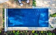 Considering an inground fiberglass swimming pool and wondering how much fiberglass pools cost? In this article, we tell you the real cost of a fiberglass pool and list the different fiberglass pool prices and options. Fiberglass Pool Prices, Fiberglass Swimming Pools, Household Expenses, Household Budget, Backyard Pool Designs, Housewarming Party, Big Family, Pool Houses, House Warming