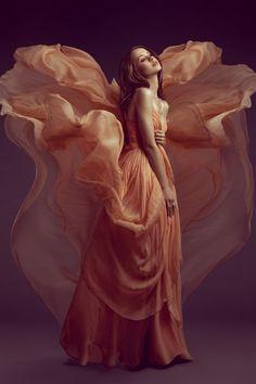 Peach flowing angel looking dress.
