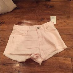 Billabong Jean shorts.. Light pink denim.  Frayed hem. Distressed on front left pocket. So cute Billabong Shorts Jean Shorts