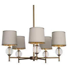 Robert Abbey's Latitude Chandelier in Aged Brass is so pretty! The combination of Oyster Gray Shades and Brass takes it to a glamorous place