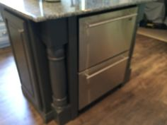 Freezer and Fridge drawers in an island by Sanford Woodworks!