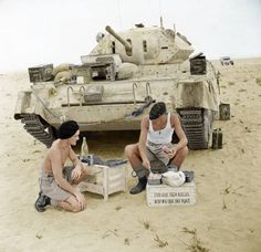 Whilst the German Afrika Korps are on their approach through the arid deserts of North Africa, a pair of British Crusader tank crew members prepare a meal in the western deserts of Egypt, an imperial possession of the British Empire at the time. British Army, British Tanks, Crusader Tank, Afrika Corps, North African Campaign, Churchill, Military Armor, Ww2 Photos, Military Pictures