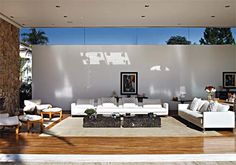 Residência Melville / Alessandra Pires e Carla Barranco #window #stone #livingroom