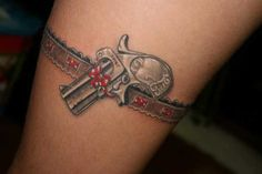 Unique Gun and Garter Tattoo