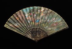 Fan  Date: first quarter 18th century Culture: French Medium: wood, paper, mother-of-pearl, gouache Dimensions: 11 1/2 in. (29.2 cm) Credit Line: Brooklyn Museum Costume Collection at The Metropolitan Museum of Art,