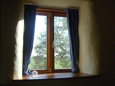 The wide window sills in the straw bale cottage
