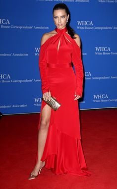 2016 White House Correspondents' Dinner 2016: Adriana Lima is wearing a red Juan Carlos Obando cold shoulder dress with a slit and key hole. Adriana is red hot gorgeous! She is on trend with the cold shoulder! Fabulous gold accessories.