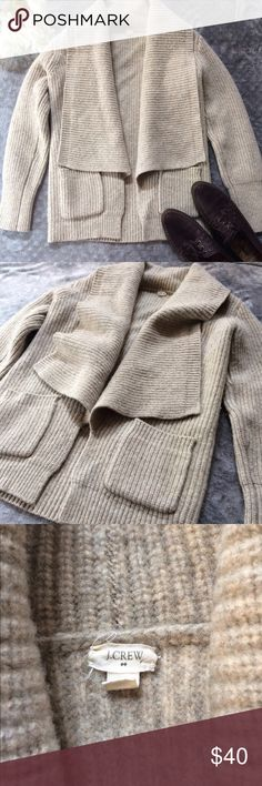 100% Lambs wool J Crew Cardigan This sweater feels like pure luxury! Super soft lambs wool, warm and cozy. It just doesn't get any better. Gently used and Dry Cleaned. J. Crew Sweaters Cardigans