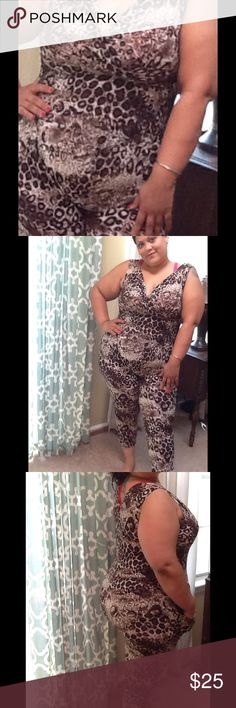 SEXY ANIMAL PRINT JUMPSUIT NEW WITH TAGS. Gorgeous and soooo comfortable. Gathered and elasticized waist.  Pant legs tapered at bottom. Wear with flats or high heels. Wear it casually or dress it up. Go out in style. Has pockets. 95% Soft Polyester, 5% elastane.  Color:   Chocolate.  Available in L/XL which fits up to 2X. And available in Sm/med which runs big and fits from large to 1X.  PLEASE DO NOT USE THIS LISTING TO PURCHASE. LET ME KNOW YOUR CHOICE IN SIZE AND I will make a separate…