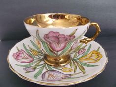 Here is a sweet vintage bone china cup and saucer set by Rosina, made in England, showing beautiful pink, yellow and lavender tulips with green