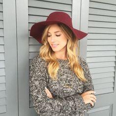 Wine colored fedora hat.