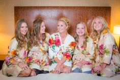 Bride and birdesmaids getting ready in floral robes. Danielle and Jason's Outdoor Fall Wedding in Crested Butte, Colorado
