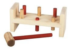 American Made First Workbench A classic wood toy, this little workbench stimulates eye hand coordination and challenges little ones to pound the pegs through the wood. Long lasting handmade wood toy. #woodtoys #toys