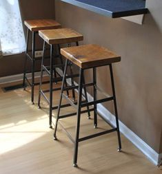 reclaimed wood top and steel base stool is a modeled after an industrial shop stool. Made in Chicago. The reclaimed wood top of each stool is Mid Century Rustic, Counter Height Bar Stools, Metal Bar Stools, Table Height, Tall Table, Wood Counter, Metal Stool, Wood Stool, Industrial Shop