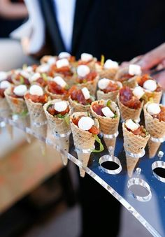 Caprese salad in a tasty waffle cone. Wedding Caprese-Salat in einem wohlschmeckenden Waffelkegel. Hochzeitsfeier und Cocktail… Caprese salad in a tasty waffle cone. Wedding party and cocktail hour meal…