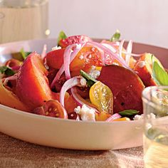 Simplicity has never looked so beautiful. A stunning combination of skin-on peaches and heirloom tomatoes of various colors, sizes, and shapes creates a sweet-savory salad that pairs well with grilled pork.View Recipe: Summer Peach and Tomato Salad Fresh Tomato Recipes, Tomato Salad Recipes, Summer Recipes, Great Recipes, Eat Better, Savory Salads, Summer Side Dishes, Cooking Recipes, Healthy Recipes