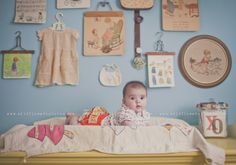 hang up dress, bib, etc. as part of a gallery wall in a baby room