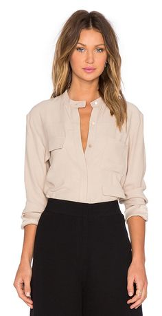 The lucid shirt by TY-LR. Viscose blend. Dry clean only. Button front closure. Front flap pockets. Button cuffed sleeves. T...