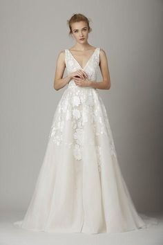 Looking for your dream wedding dress? Click to see pictures of gowns we love