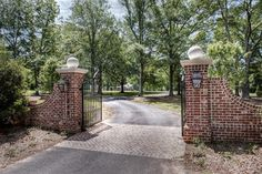 Gabriel Builders - traditional - landscape - other metro -  Traditional brick front entry gates with brick and coach lamps.
