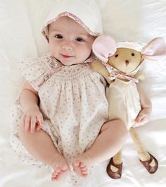 Sweet baby girl with her bestie from Hazel Village and matching eyelet pattern bonnet with floral trim from Briar Handmade sold exclusively at Noble Carriage. Simple and gorgeous and perfect for spring / summer.