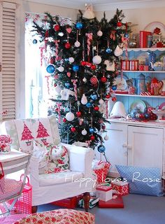 upside down Christmas tree; love the white hutch with blue background with all the red and blue items.  fun, fun, fun