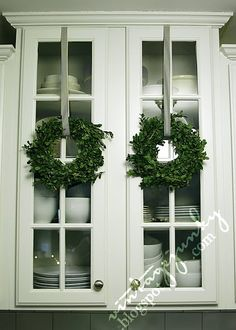 Boxwood wreaths:::love to put Christmas everywhere