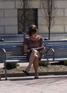 reading outside  A park bench is probably a favourite place to read.