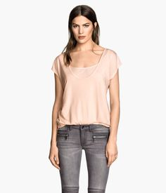 3e1fa7b262568 Nursing top in soft jersey with short sleeves. Scoop neckline and practical  inner top for