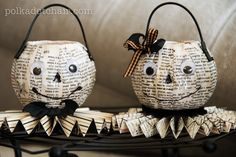 Mr. & Mrs. O'Lantern made by using mod podge and paper over cheap plastic pumpkins