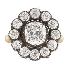 A VICTORIAN DIAMOND CLUSTER RING - Bentley & Skinner