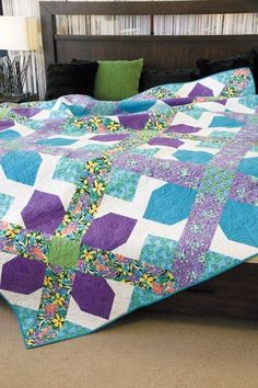 12 big, beautiful patchwork quilt blocks are all you need for this queen-size quilt pattern! Cross it Out, by Sarah Maxwell, is fun to piece and the diagonal sashing creates a lovely secondary design with a lattice effect. Patchwork Quilt Patterns, Scrappy Quilts, Quilt Patterns Free, Colchas Quilting, Quilting Designs, Quilting Ideas, Quilt Design, Quilting Tutorials, Purple Quilts