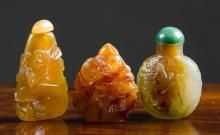 THREE CHINESE CARVED STONE SNUFF BOTTLES in variou